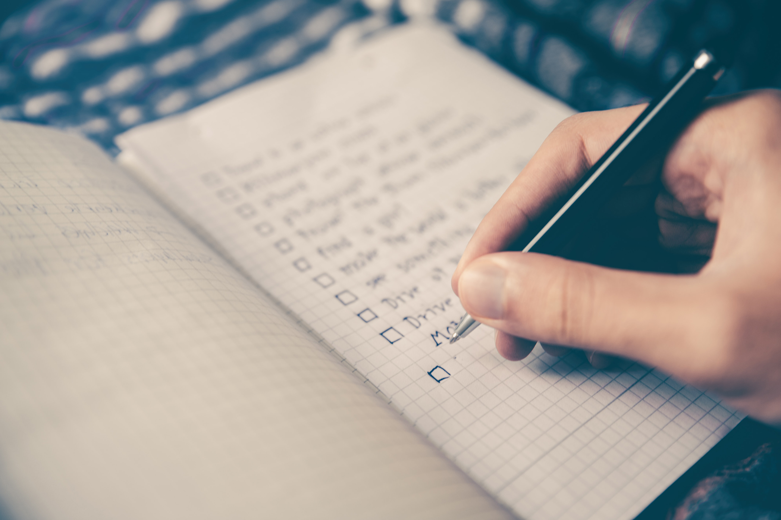 Hand checking off a to-do list.