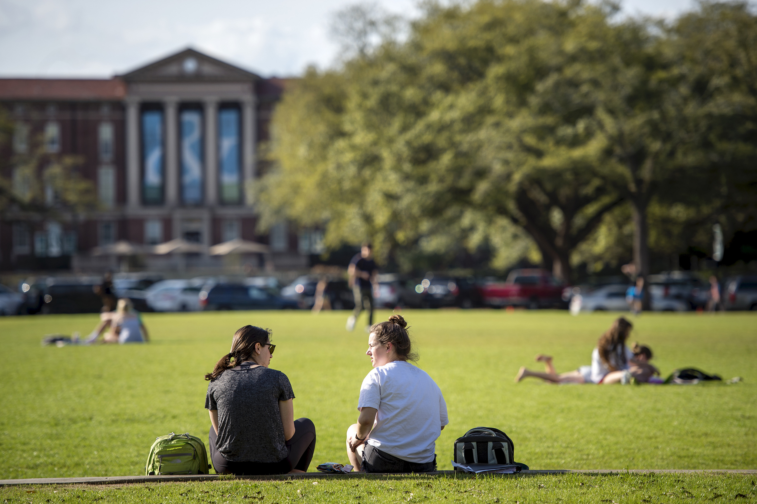 Students sunning themselves on the Newcomb Quad.